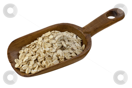 Scoop of rolled oats stock photo, Rolled oats on a rustic wooden scoop isolated on white by Marek Uliasz