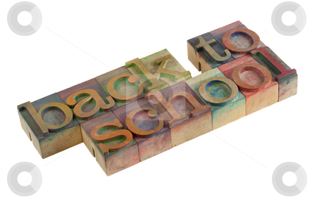 Back to school concept stock photo, Back to school words in vintage wooden letterpress type blocks, stained by color ink, isolated on white by Marek Uliasz
