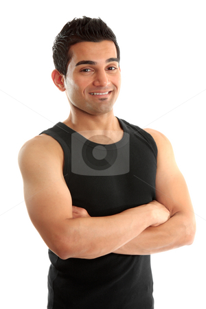 Athletic fitness instructor or builder stock photo, Athlete,body builder, fitness instructor, personal trainer, builder, tradesmen, or other labourer wearing black tank top, arms crossed and smiling.  White background. by Leah-Anne Thompson