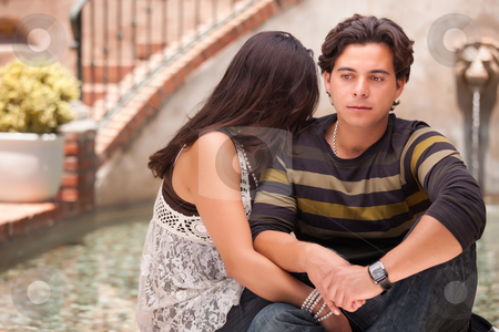 Attractive Hispanic Couple During A Serious Moment stock photo, Attractive Hispanic Couple During A Serious Moment at a Fountain. by Andy Dean