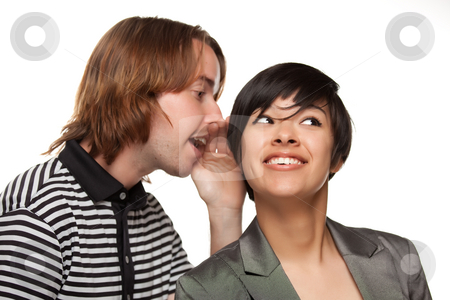 Attractive Diverse Couple Whispering Secrets stock photo, Attractive Diverse Couple Whispering Secrets Isolated on a White Background. by Andy Dean