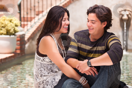 Attractive Hispanic Couple At A Fountain stock photo, Attractive Hispanic Couple Ejoying Each Other At A Fountain. by Andy Dean