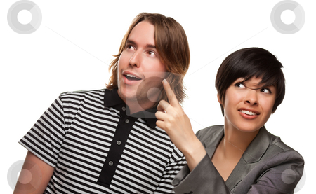 Diverse Caucasian Male and Multiethnic Female Pointing Up stock photo, Diverse Caucasian Male and Multiethnic Female Pointing and Looking Up and Over Isolated on a White Background. by Andy Dean