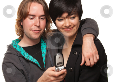 Diverse Couple Using Cell Phone stock photo, Diverse Couple Using Cell Phone Isolated on a White Background. by Andy Dean