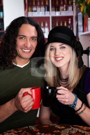 Interracial couple  stock photo, Interracial couple together at a coffee house by Scott Griessel