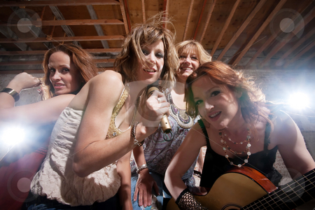 Female musicians stock photo, All girl band performing in stylish clothing by Scott Griessel