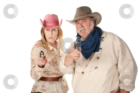 Western Wear Couple stock photo, Couple in western wear pointing pistols with serious faces by Scott Griessel