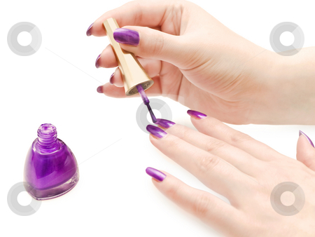 Manicure stock photo, Manicure process: nail polish and woman hands over white background by Sergej Razvodovskij