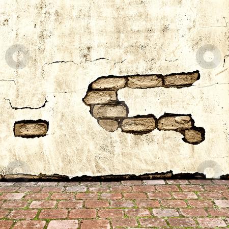Exterior stock photo, Photo of grunge wall background with brick floor by Sergej Razvodovskij