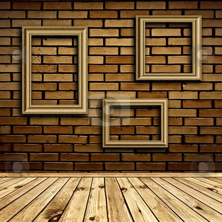 Interior with frames stock photo, Three frames at beige brick wall under wooden floor by Sergej Razvodovskij