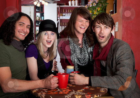 Couples together stock photo, Young couples posing together at a bistro by Scott Griessel