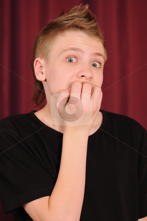 The surprised teenager stock photo, Portrait of the surprised teenager in a black vest by Salauyou Yury