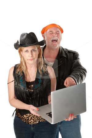 Not so funny stock photo, Serious woman with loud mouth friend laughing at silly or offensive content by Scott Griessel