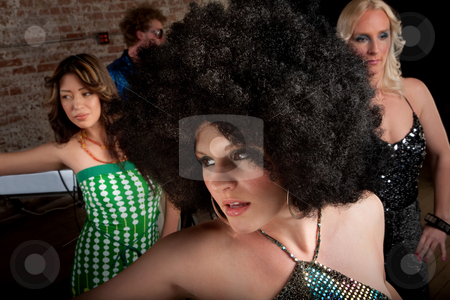 1970s Disco Music Party stock photo, Pretty girl dancing with afro at a 1970s Disco Music Party by Scott Griessel