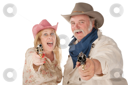 Couple in western wear pointing pistols  stock photo, Couple in western wear pointing pistols and laughing by Scott Griessel