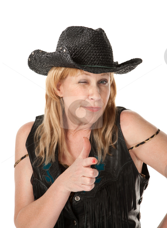 Winking western woman making a pistol with her hand stock photo, Winking middle-aged woman with black cowboy hat by Scott Griessel