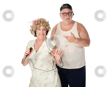 Dancing Girl stock photo, Wife dancing to music with a puzzled husband by Scott Griessel