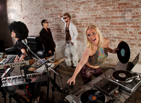1970s Disco Music Party stock photo, Female DJs dancing and playing music at a party by Scott Griessel