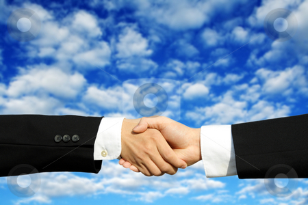 Business deal stock photo, Two businessmen shaking hands on a successful deal by Suprijono Suharjoto