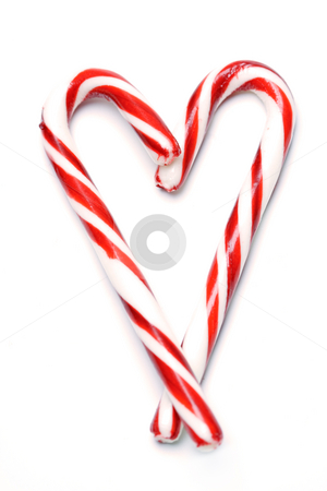 Christmas candy cane stock photo, A shot of christmas candy cane in a heart shape by Suprijono Suharjoto