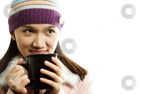 Drinking stock photo, A beautiful girl wearing winter dress holding a cup of hot drink by Suprijono Suharjoto