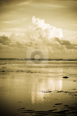 Clouds and sky stock photo, A shot of dramatic sky and clouds on the beach during sunset by Suprijono Suharjoto