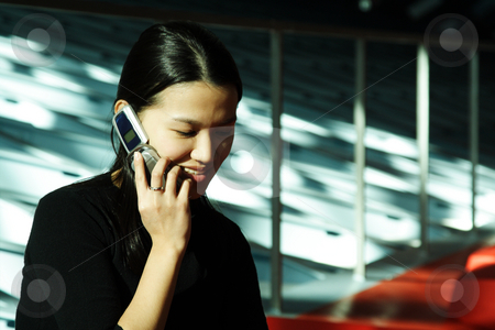 Businesswoman stock photo, A businesswoman talking on a cell phone by Suprijono Suharjoto