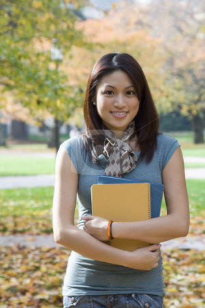 College student stock photo, A beautiful college student carrying books at the campus by Suprijono Suharjoto