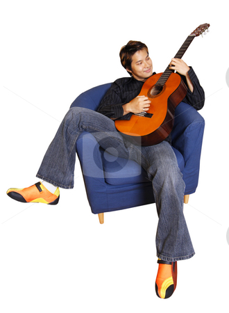 Guitar player stock photo, Young man playing guitar (isolated) by Suprijono Suharjoto