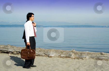 Relaxing businessman stock photo, A businessman on a break and relaxing on the beach by Suprijono Suharjoto
