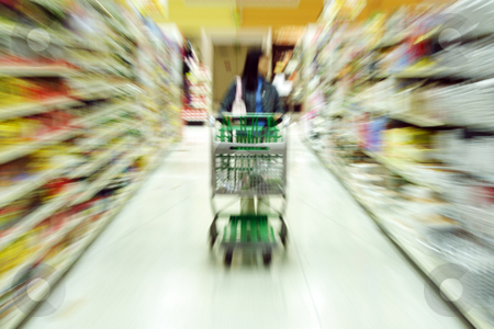 Grocery shopping stock photo, A woman shopping in a grocery store/supermarket by Suprijono Suharjoto