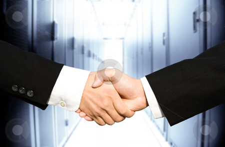 Businessmen shaking hands stock photo, Two businessmen shaking hands in a technology data center by Suprijono Suharjoto