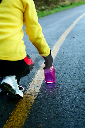 Exercise stock photo, A woman getting ready for exercise and running by Suprijono Suharjoto