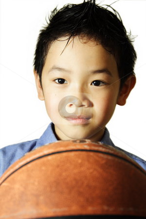 Smiling boy stock photo, A portrait of a young boy with a basketball by Suprijono Suharjoto