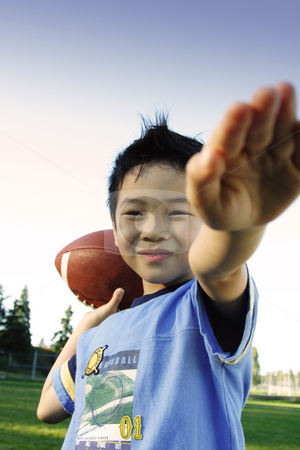 Football player stock photo, A boy playing football outdoor by Suprijono Suharjoto