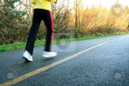 Afternoon run stock photo, A woman exercising and running in the afternoon by Suprijono Suharjoto