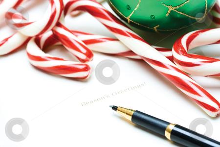 Christmas greeting card stock photo, A shot of a christmas greeting card with candy canes and christmas ornament by Suprijono Suharjoto