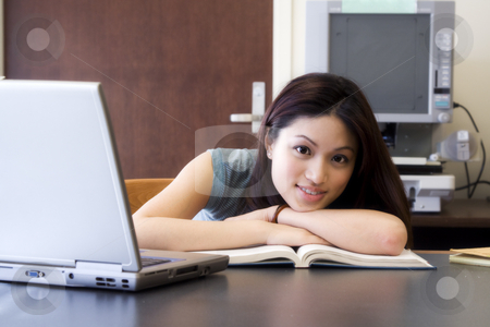 College student stock photo, A beautiful college student studying at the library by Suprijono Suharjoto