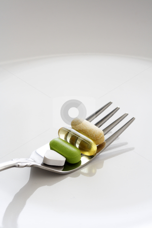 Healthcare stock photo, A shot of vitamin and medicines on a fork by Suprijono Suharjoto
