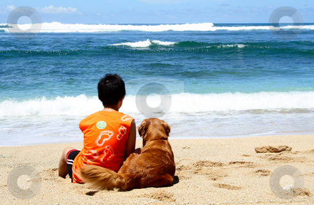 Best friends stock photo, A boy and a golden retriever sitting on the beach by Suprijono Suharjoto