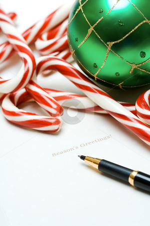 Christmas greetings stock photo, A shot of christmas card and christmas ornament and candy canes by Suprijono Suharjoto