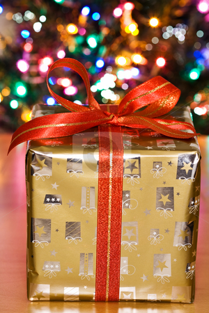 Christmas present stock photo, A shot of a christmas present in front of a christmas tree by Suprijono Suharjoto