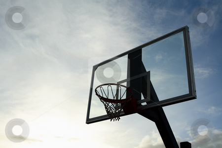 Basketball hoop stock photo, Outdoor basketball hoop on a cloudy day by Suprijono Suharjoto