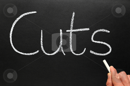 Writing cuts with white chalk on a blackboard. stock photo, Writing cuts with white chalk on a blackboard. by Stephen Rees