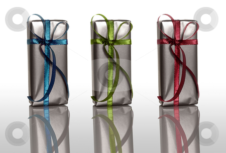 Beautiful gift boxes stock photo, Beautiful colored Christmas boxes isolated on white with reflection by ikostudio