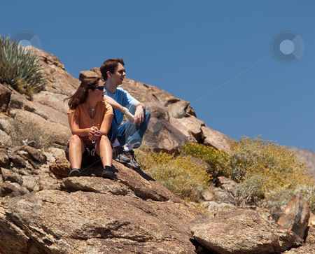 Hikers in desert look at distant object stock photo, Male and female hikers in Anze Borrego desert look to distance by Steven Heap