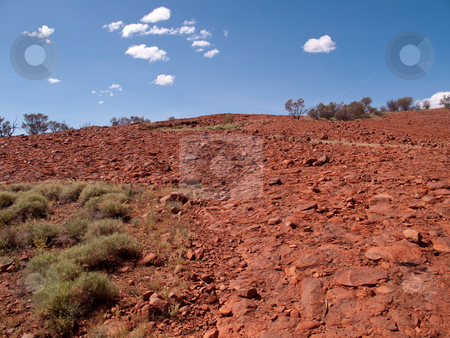Rough rock at Ayers stock photo, Broken rock as you climb the hillside at Ayers Rock in Australia by Steven Heap
