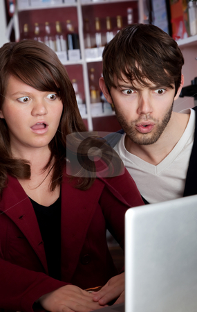 Web Wierdness stock photo, Woman and man staring in disbelief at a laptop by Scott Griessel