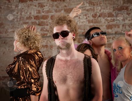 Bare chested man at disco party stock photo, Disco pose with friends at a 1970s Disco Music Party by Scott Griessel