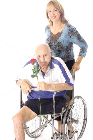 Happy woman pushing handicap man stock photo, Shot of a happy woman pushing handicap man by Andi Berger